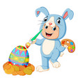 a boy wearing rabbit costumes and painting a egg vector image vector image