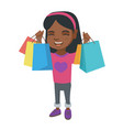 happy african-american girl holding shopping bags vector image vector image