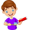 cute little boy squeezing toothpaste vector image vector image