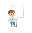 cute boy standing with blank signboard kid vector image vector image