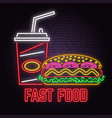 retro neon hot dog and cola sign on brick wall vector image vector image