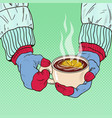 hands in mittens holding mug with hot tea vector image vector image