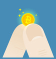 fingers hold a small bitcoin vector image vector image