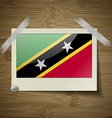 Flags Saint Kitts Nevis at frame on wooden texture vector image