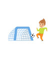 cute littlle boy playing football kid having fun vector image vector image