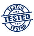 tested blue round grunge stamp vector image vector image