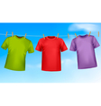 Set of colored t-shirts hanging on a clothesline vector image