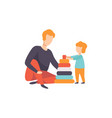 father playing pyramid toy with his son dad and vector image vector image