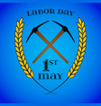 may 1st labor day crossed pickaxes and wheat vector image vector image