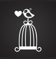 bird and love cage on black background vector image
