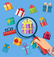 gift boxes and hand with magnifying glass vector image vector image