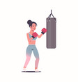 woman boxer doing exercises with punching bag vector image