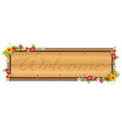 A wooden signboard with a welcome sign vector image vector image