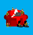 santa claus on chair working in laptop elf vector image vector image
