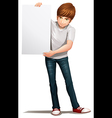 A handsome young man holding an empty signboard vector image vector image