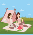 teenagers sitting on the ground in front of tents vector image vector image