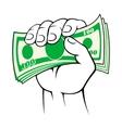 Cash money in hand vector image vector image