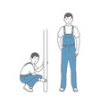 two figures of male workers in overalls locksmith vector image vector image