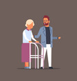 man helping senior woman with walking frame vector image
