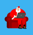santa claus on chair working in laptop christmas vector image vector image