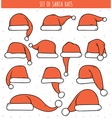 Set of 12 red doodle hats Santa Claus vector image vector image