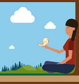 girl sitting on groud outdoors hold bird on hand vector image