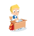 Schoolboy sitting at school desk Pupil vector image vector image