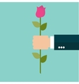 Rose Flower in a Business Man Hand vector image vector image