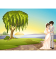 a couple across tree vector image