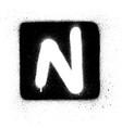 graffiti n font sprayed in white over black square