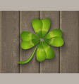lucky clover on wooden background vector image vector image