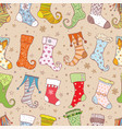 seamless background with christmas gift socks vector image vector image