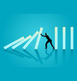 businessman trying to stop domino effect vector image vector image