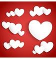 White paper hearts on red background vector image
