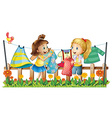 Two girls drying their clothes vector image vector image