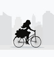 girl rides bicycle on background of city vector image
