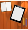 Notepad and pencils on the table vector image vector image