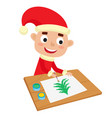 little santa boy artist at table and painting vector image