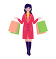 woman in coat with packages vector image vector image