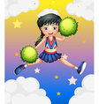 A cheerleader jumping with her green pompoms vector image vector image