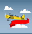 airplane with banner in sky vector image