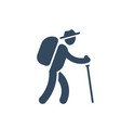 person with backpack and stick walking hiking vector image vector image