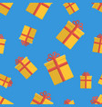 seamless pattern with gift boxes on blue vector image vector image