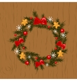 Christmas wreath on wooden background vector image