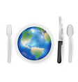 earth planet on a dish with knife fork and spoon vector image vector image