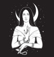 beautiful brunette witch with serpent in her hands vector image