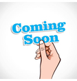 Coming Soon word in hand vector image
