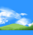 Green grass field with blue sky
