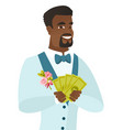 young african-american groom holding money vector image vector image