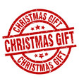 christmas gift round red grunge stamp vector image vector image